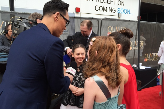 Jaime Adler being interviewed on the red carpet by Gok Wan, The Olivier Awards 2015