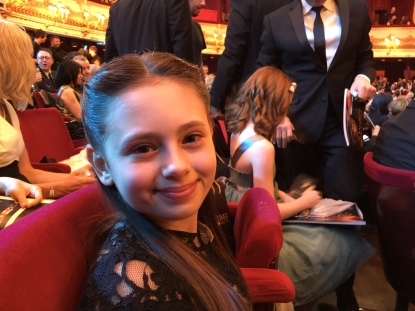 Jaime Adler sat in The Royal Opera House, before the Olivier Awards begin